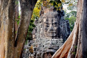 A stone tower of Victory Gate inside Angkor Thom depicts the smiling face of the king portrayed as Boddhisattava Avalokitesvara (Buddha)